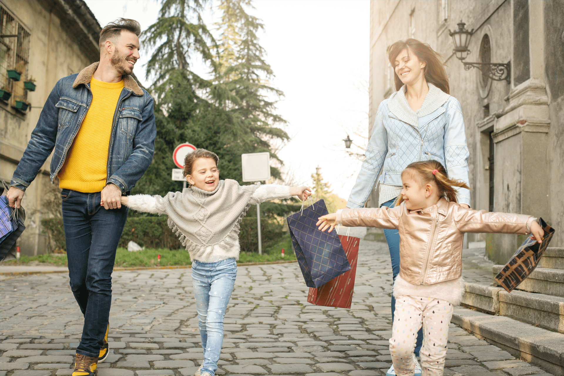 Family smiling together while walking through a courtyard